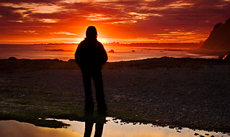 person standing in sunset