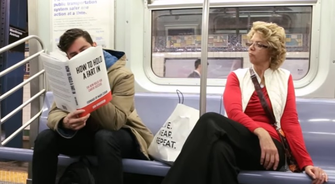 Guy Reads Books With Fake Covers In Public – The Reactions Of People Around Him Are Priceless thumbnail